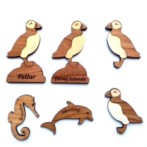 Laser-cut wooden fridge magnets - seahorse, puffins, dolphin