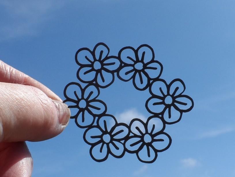 Laser-cut hand-drawn flower vector