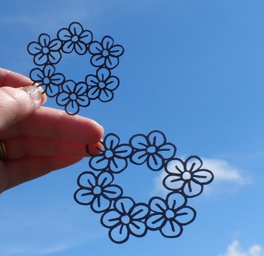Laser-cut hand-drawn flower vectors
