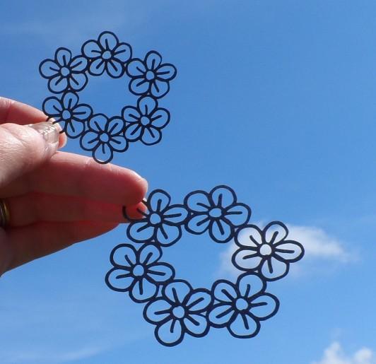 Laser-cut hand-drawn flower vectors