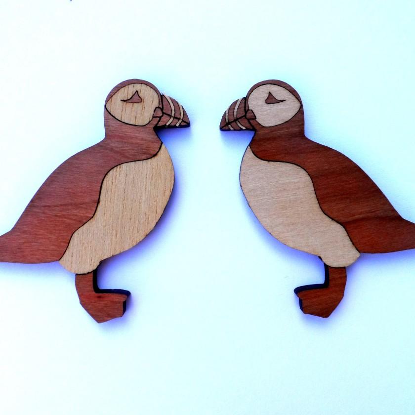 Laser-cut wooden fridge magnets - puffins