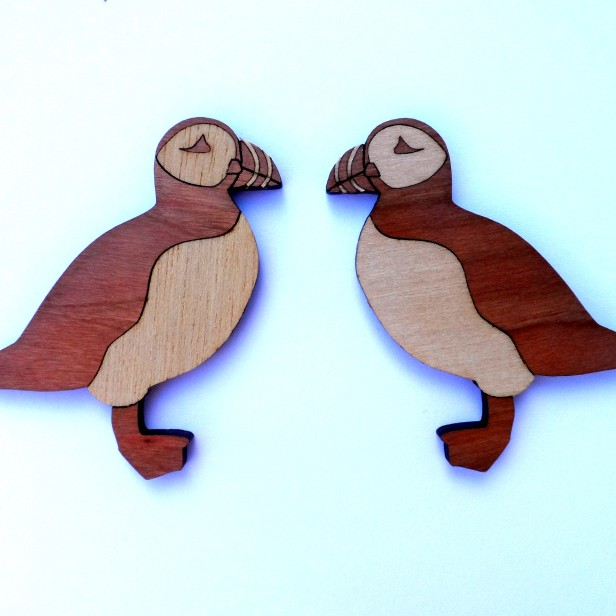 Laser-cut wooden fridge magnets - puffins