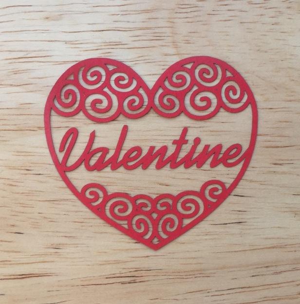 valentine red heart swirly filigree papercut