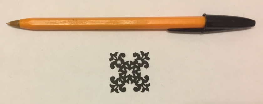 papercut 027 with pen for scale