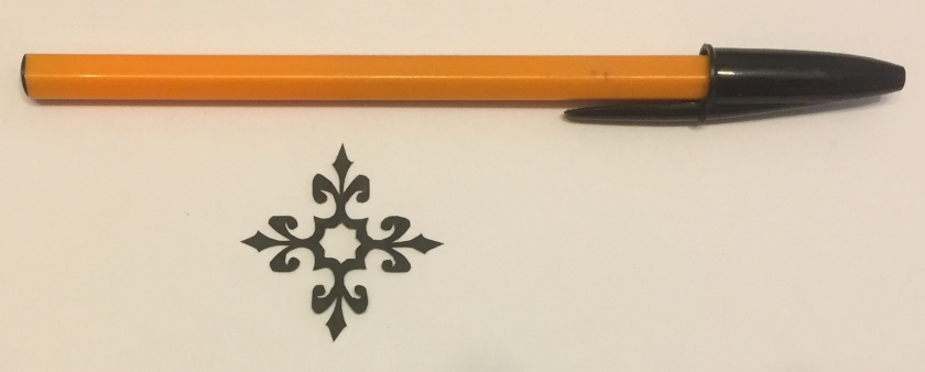 papercut 040 with pen for scale